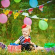 Happy little girl licks sweet candy nature summer outdoor — Zdjęcie stockowe