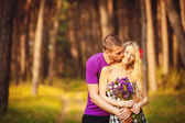 Happy young couple in love at the park. — Stock Photo