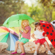 Stock Photo: Cute happy children playing in spring filed