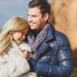 Portrait of a beautiful young couple on a background of mountain scenery — Stock Photo #37929649