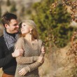 Portrait of a beautiful young couple on a background of mountain scenery — Stock Photo #37929693