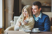 Romantic Young Couple Embracing and having fun indoor — Stock Photo