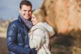 Portrait of a beautiful young couple on a background of mountain scenery — Stock Photo