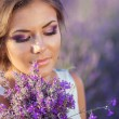 Beautiful woman and a lavender field — Stock Photo #38022413