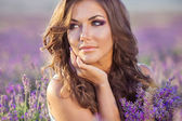 Beautiful woman and a lavender field — Stock Photo