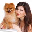 Happy woman and her beautiful little red dog spitz over white background close portrait — Stock Photo #38044797