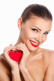 Portrait of Beautiful gorgeous smiling woman with glamour bright makeup and red heart in hand — Stock Photo