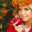 Portrait of smiling beautiful woman wreath of berries in autumn colors — Stock Photo