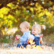 Cute boy and girl playing together summer outdoors — Stock Photo #38238889