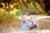 Cute boy and girl playing together summer outdoors — Stock Photo
