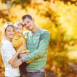 Happy family having fun outdoors in autumn in the park — Stock Photo #38459919