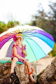Adorable toddler girl playing outdoors in green summer park — Stock Photo