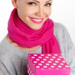 Beautiful woman a gift from a loved one for the holiday — Stock Photo #38641573