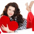 Valentine's Day. Beautiful smiling woman with a gift in the form of heart in his hands — Stock Photo #38643807
