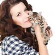 Portrait of a Young pretty woman holding her lovely little cat isolated on a white background — Stock Photo