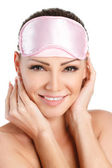 Close-up portrait of young beautiful Naked shoulders woman with pink blindfold on her eyes isolated on white background — Stock Photo