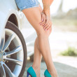 Young pretty lady with a modern luxury car — Stock Photo #38651999