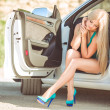 Young pretty lady with a modern luxury car — Stock Photo #38652059