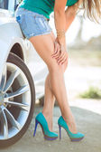 Young pretty lady with a modern luxury car — Stock Photo