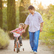 Dad and son walking in the park in summer — Stock Photo #38754925