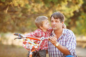 Dad and son walking in the park in summer — Stock Photo