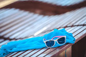 Reflecting sunglasses on the beach — Stock Photo