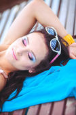 Young beautiful woman on a beach — Stock Photo