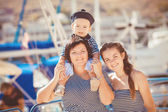 Mom, daughter and son rest in the summer on the beach — Stock Photo