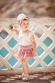 Little girl on walk in the summer outdoors — Stock Photo