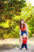 Baby boy with his mum in the park — Stock Photo