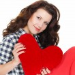 Love and Valentine's Day, a woman holding a red heart. Beautiful brunette woman in love. — Stock Photo #39226527