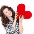 Love and Valentine's Day, a woman holding a red heart. Beautiful brunette woman in love. — Stock Photo