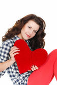 Love and Valentine's Day, a woman holding a red heart. Beautiful brunette woman in love. — Stockfoto