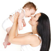 Happy cheerful family. Mother and baby having fun — Stock Photo
