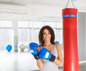Close-up portrait of young attractive woman training on simulator in gym — Stock Photo