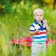 Little smiling boy with toy bucket outdoors — Stok fotoğraf