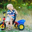 Little smiling boy on toy bicycle — Stock Photo #39671593