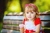 Portrait of beautiful little girl in summer green park — Stock Photo