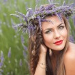 Portrait of young woman in lavender wreath. Fashion, Beauty — Stock Photo #39747357