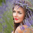 Portrait of young woman in lavender wreath. Fashion, Beauty — Stock Photo #39747389