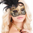 Portrait of Beautiful young blonde woman in black and gold mysterious venetian mask. Fashion photo on white background — Stock Photo