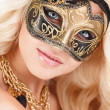 Portrait of Beautiful young blonde woman in black and gold mysterious venetian mask. Fashion photo on white background — Stock Photo #39885127