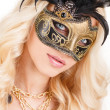 Portrait of Beautiful young blonde woman in black and gold mysterious venetian mask. Fashion photo on white background — Stock Photo #39885129