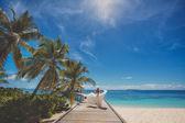 Bride on beautiful Maldivian beach — Stock Photo