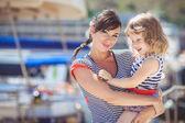 Happy Family having fun by the sea boats and yachts — Stock Photo