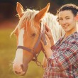 Portrait beautiful woman next horse in warm summer sunny day — Stock Photo