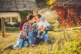 Young happy family having fun at countryside — Stock Photo