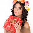 Woman with autumn hairstyle holding gift box. — Stock Photo