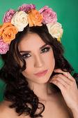 Beautiful young woman with floral wreath. Fashion shot. Closeup portrait. Fashion jewelry. Beauty portrait. — Stock Photo