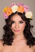 Studio portrait of a beautiful woman with wreath — Stock Photo